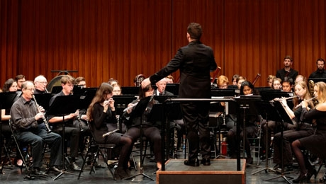 Dartmouth Wind Ensemble director Brian Messier conducting during a concert.