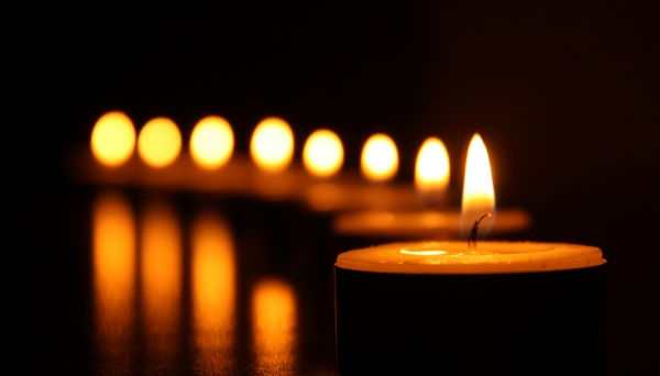Tealight candles on a black background for the Brothers and Sisters Vigil