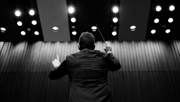 ensemble conductor with hands in air