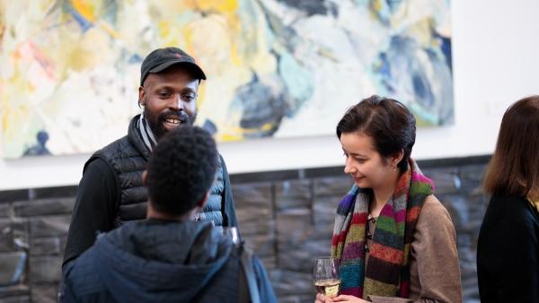 people talking in an art gallery
