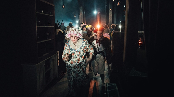 students in costume backstage during a dress rehearsal of Into the Woods