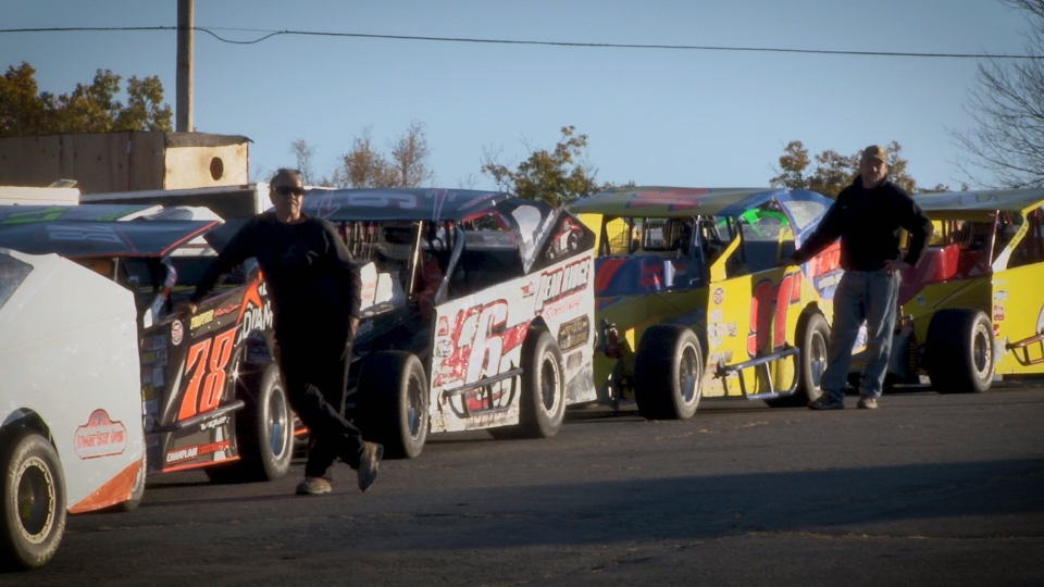 Upper Valley locals next to their race cars