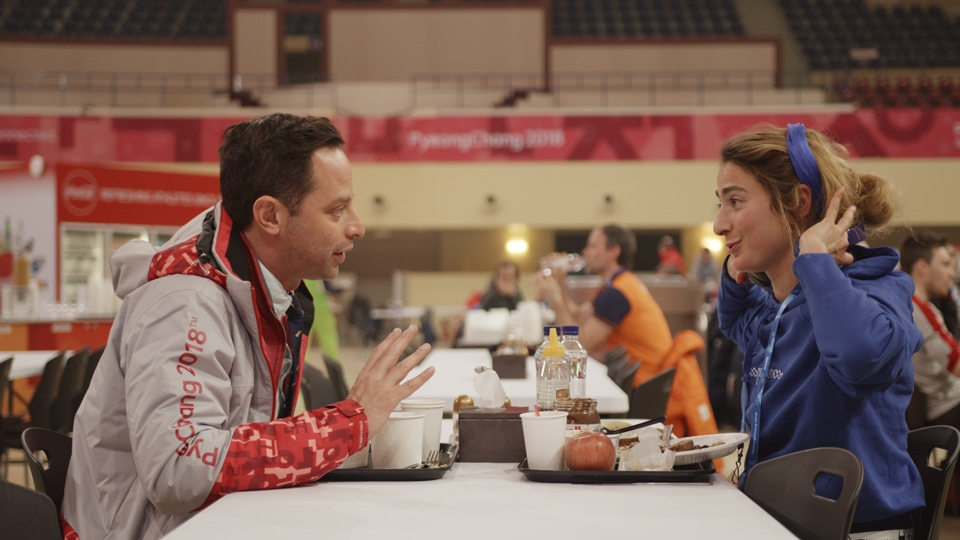 man and woman talking in cafeteria in Olympic Dreams