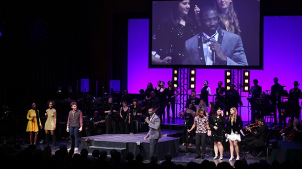 Walt Cunningham on stage with the Dartmouth Idol contestants